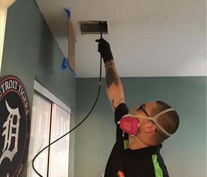 SERVPRO of Weston/West Davie is using high tech duct cleaning equipment to hepa vacuum the duct work in this West Davie home